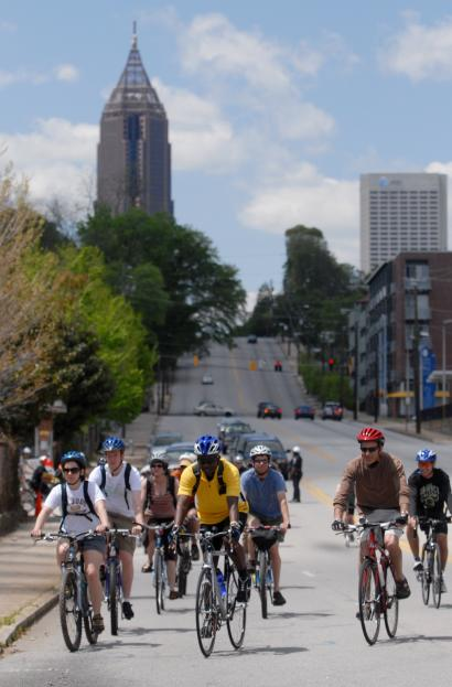 A photo of my boyfriend's & my first date with 400 other people on the inaugural BeltLine Bike Ride. He's in the picture tot he far right in the black shirt. I got cut off on the other side of him. :-) (photo by Todd R. McQueen for the AJC)