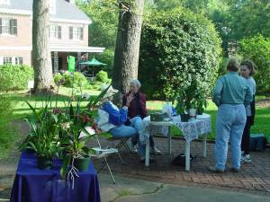 Lullwater Garden Club members volunteer to staff the table to raise money for the Lullwater Conservation Garden